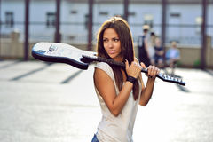 Attractive young woman with guitar - outdoor fashion portrait Stock Photography