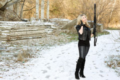 Attractive young woman with a gun Stock Photos