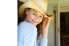 Attractive young woman with hat at home. Close up portrait of attractive young woman with hat at home Stock Photos