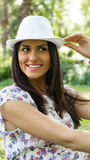 Attractive young woman with hat. Looking away, sunny day Royalty Free Stock Photography