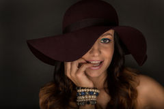 Attractive young woman with hat. Portrait of attractive young woman with hat Stock Photos