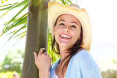 Attractive young woman in hat smiling outdoors. Close up portrait of attractive young woman in hat smiling outdoors Royalty Free Stock Photo