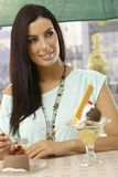 Attractive woman having cake smiling Royalty Free Stock Photos