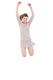 Attractive young woman having fun jumping in the air barefoot Stock Image