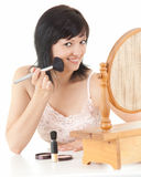 Attractive young woman having make-up Royalty Free Stock Photos