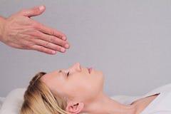 Attractive young woman having reiki healing treatment , alternative  medicine concept. Royalty Free Stock Photos