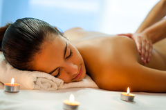 Attractive young woman having relaxing massage in spa. Stock Photo