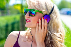 Attractive young woman with headphones Royalty Free Stock Photo
