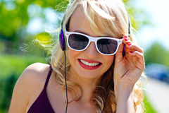 Attractive young woman with headphones Stock Image