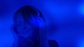 Attractive young woman with headphones music background Royalty Free Stock Image