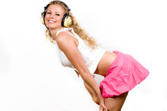 Attractive young woman with headphones over white Royalty Free Stock Image