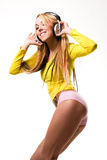 Attractive young woman with headphones over white Stock Photo