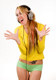 Attractive young woman with headphones over white Stock Photos