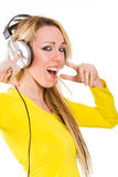 Attractive young woman with headphones singing Royalty Free Stock Images