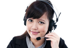 Attractive young woman with headset Royalty Free Stock Photography
