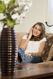 Attractive Young Woman On Her Cell Phone At Home Stock Image