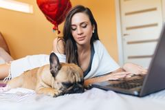Attractive young woman with her dog stock images