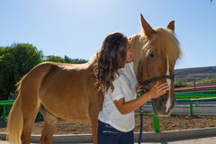 Attractive young woman with her horse at the Royalty Free Stock Photos