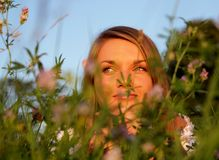 Attractive young Woman in high flower meadow Royalty Free Stock Photos