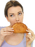 Attractive Young Woman Holding a Baked Fresh Cornish Pasty Stock Photo