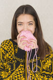 Attractive young woman holding a ball of yarn Royalty Free Stock Photography