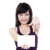 Attractive Young Woman Holding Blank Note Card stock image