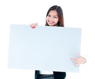 Attractive Young Woman Holding Blank Signboard. Portrait of a happy young woman holding blank signboard, isolated on white background Royalty Free Stock Images