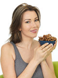 Attractive Young Woman Holding a Bowl of Savory Twigglets Finger Stock Photography