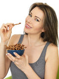 Attractive Young Woman Holding a Bowl of Savory Twigglets Finger Royalty Free Stock Photo