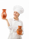 Attractive young woman holding clay jugs Stock Image