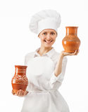 Attractive young woman holding clay jugs Stock Images