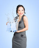 Attractive young woman holding cleaning equipment Stock Photo