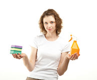 Attractive young woman holding cleaning supplies Royalty Free Stock Photo