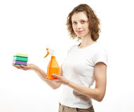 Attractive young woman holding cleaning supplies Royalty Free Stock Images