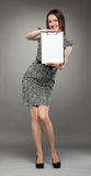 Attractive young woman holding a clipboard Royalty Free Stock Images