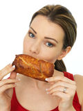 Attractive Young Woman Holding a Cooked Hot Savory Sausage Roll Stock Images