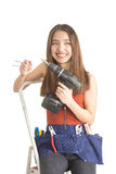 Attractive young woman holding cordless screwdriver Stock Photography