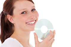 Attractive young woman holding dvd Stock Photography
