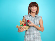 Attractive young woman holding easter eggs basket Stock Images