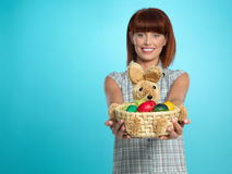 Attractive young woman holding easter eggs basket Royalty Free Stock Image