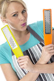 Attractive Young Woman Holding Food Graters Stock Photo