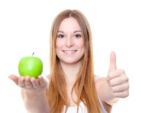 Attractive young woman holding green apple Royalty Free Stock Photos