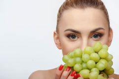 Attractive young woman is holding green healthy Stock Photo