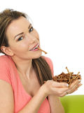 Attractive Young woman Holding A Handful Of Savory Twigglets Royalty Free Stock Image