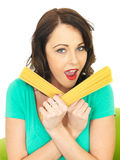 Attractive Young Woman Holding Handfulls of Dried Spaghetti Pasta Royalty Free Stock Photos