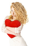 Attractive young woman holding heart Stock Photo