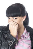 Attractive Young Woman Holding Her Nose From a Bad Smell Stock Images