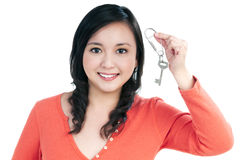 Attractive young woman holding a key Stock Photo