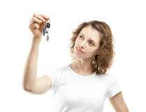 Attractive young woman holding keys Stock Photo
