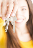 Attractive young woman holding keys Royalty Free Stock Photography